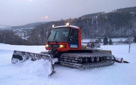 Jízda sněžnou rolbou po sjezdovce